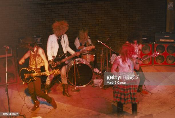 Izzy Stradlin Duff McKagan Steven Adler Axl Rose and Slash of the rock band 'Guns n' Roses' perform onstage at the Troubadour with the 'Appettite for...