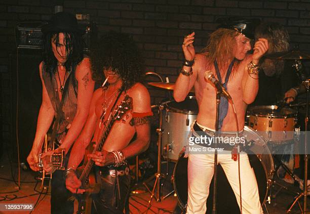 Izzy Stradlin Slash and Axl Rose of the rock band 'Guns n' Roses' performs onstage at the Troubadour where they played 'Rocket Queen' for the first...