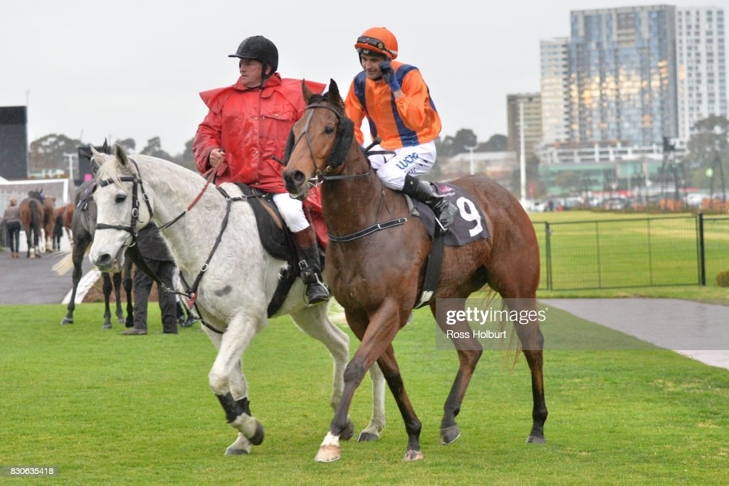 /j9 returns to the mounting yard on Sunday Escape after winning the VRC Member Charles White Handicap at Flemington Racecourse on August 12, 2017 in Flemington, Australia.