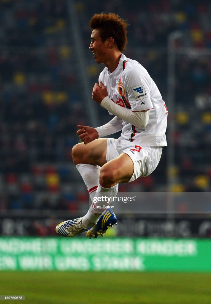 Ja Cheol Koo of Augsburg celebrates after scoring his teams second goal during the Bundesliga match between Fortuna Duesseldorf 1895 and FC Augsburg...