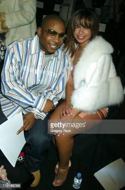 Ja Rule and Mya during Olympus Fashion Week Fall 2004 Luca Luca Front Row and Backstage at The Tent at Bryant Park in New York City New York United...
