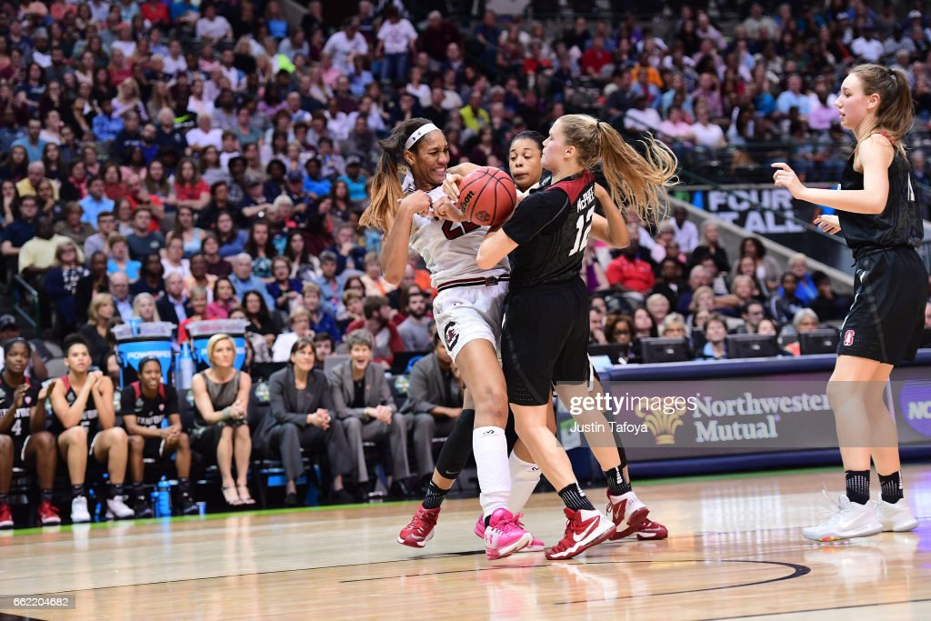 A'ja Wilson #22 of the South Carolina Gamecocks and Brittany McPhee #12 of the Stanford Cardinal fight for the ball during the 2017 Women's Final Four at American Airlines Center on March 31, 2017 in Dallas, Texas.