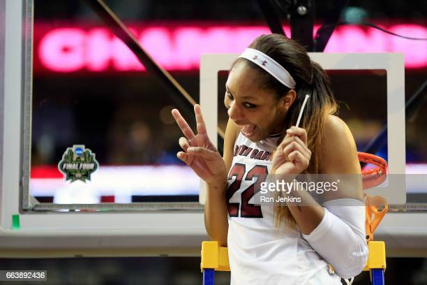 A'ja Wilson of the South Carolina Gamecocks cuts down the net after her teams championship win over the Mississippi State Lady Bulldogs after the...