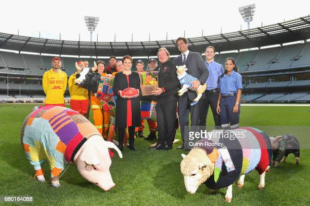 Jaala Pulford the Minister for Agriculture and Regional Development Kevin Sheedy and AFL CEO Gillon McLachlan pose with volunteers during the 2017...