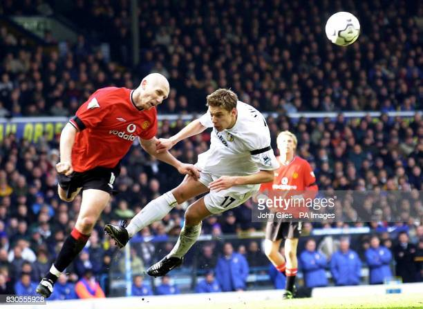 LEAGUE Jaap Stam of Manchester United and Alan Smith of Leeds United both go for a high ball during their FA Premiership football match at Elland...