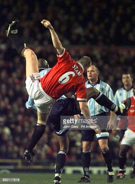 FEATURE Jaap Stam of Manchester United at full stretch to keep out a Middlesbrough attack in their FA Cup Third Round Match at Old Trafford today...