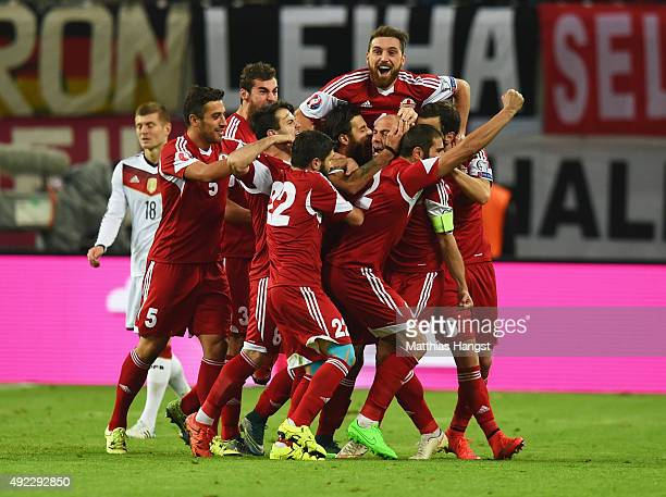 Jaba Kankava of Georgia celebrates with team mates as he scores their first and equalising goal during the UEFA EURO 2016 Group D qualifying match...
