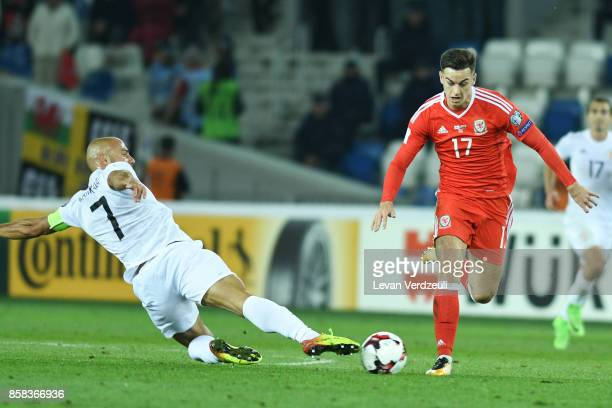 Jaba Kankava of Georgia slides in to tackle Tom Lawrence of Wales in action during the FIFA 2018 World Cup Qualifier between Georgia and Wales at...