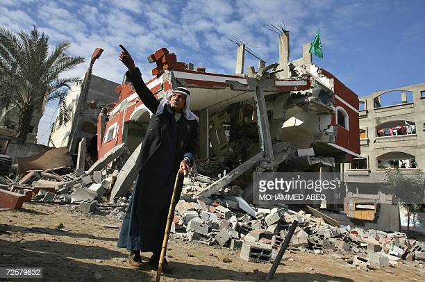 An elderly Palestinian stands in front of a damaged house destroyed by an overnight Israeli airstrike on the northern Gaza Strip refugee camp of...