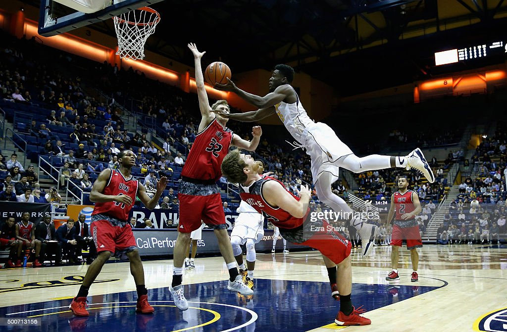 Jabari Bird of the California Golden Bears goes up for a shot against Kyle Hittle and Jerred Kite of the Incarnate Word Cardinals at Haas Pavilion on...