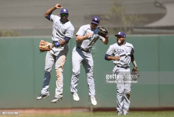 Jabari Blash Hunter Renfroe and Manual Margot of the San Diego Padres celebrate defeating the San Francisco Giants 52 at ATT Park on July 23 2017 in...