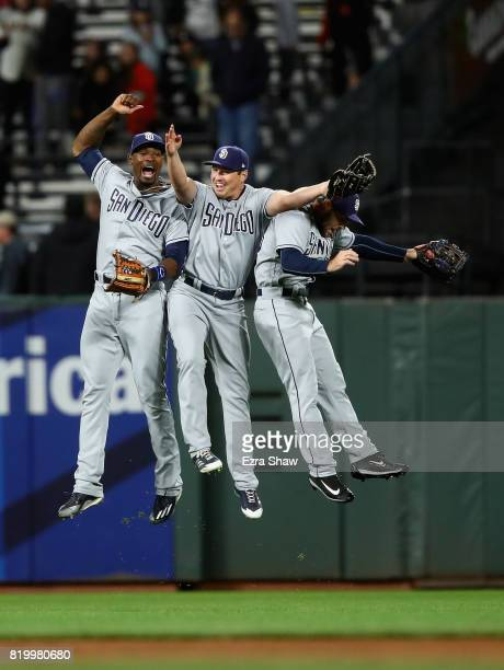 Jabari Blash Hunter Renfroe and Matt Szczur of the San Diego Padres celebrate after they beat the San Francisco Giants at ATT Park on July 20 2017 in...