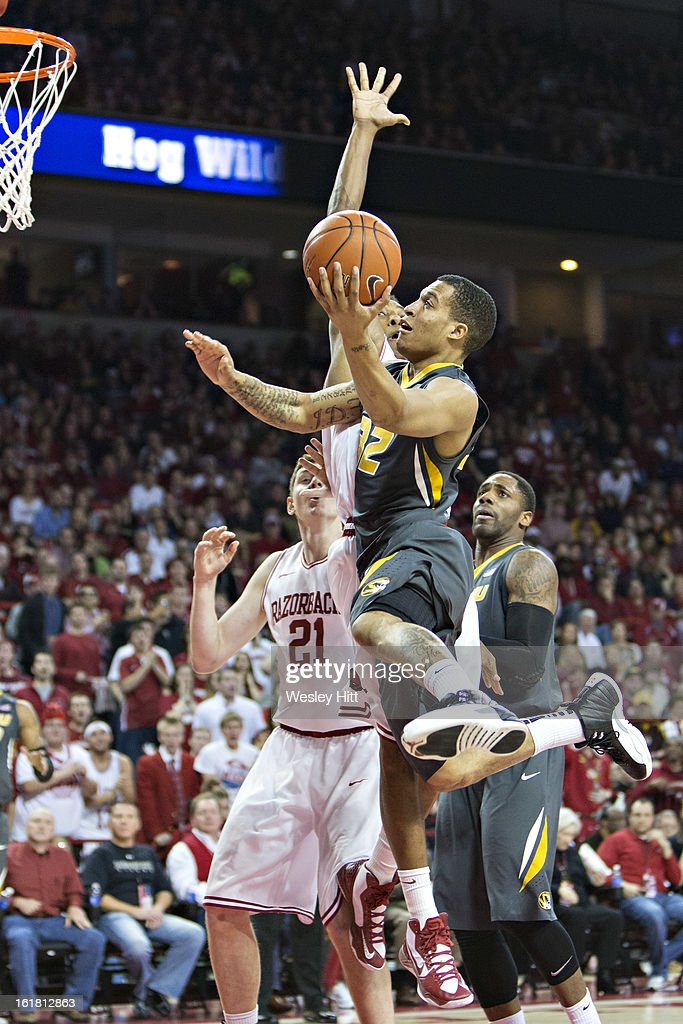 Jabari Brown #32 of the Missouri Tigers goes up for a shot over the defense of the Arkansas Razorbacks at Bud Walton Arena on February 16, 2013 in Fayetteville, Arkansas. The Razorbacks defeated the Tigers 73-71.