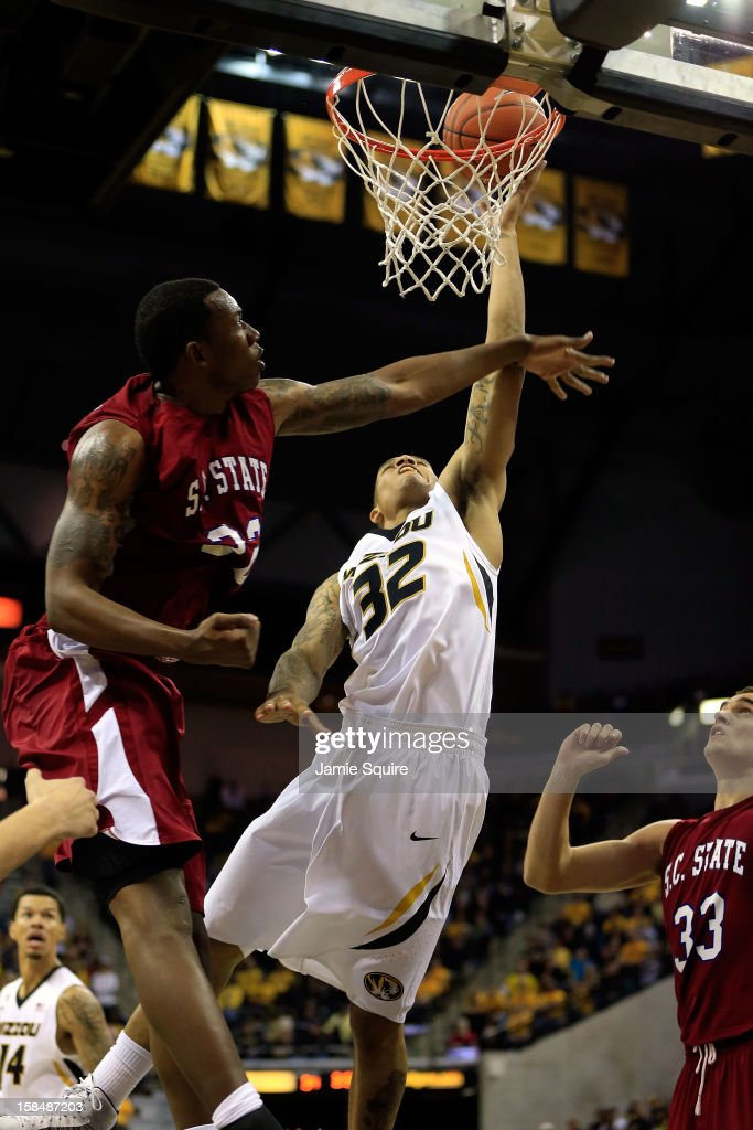 Jabari Brown of the Missouri Tigers shoots as Matthew Hezekiah of the South Carolina State Bulldogs defnds during the game at Mizzou Arena on...