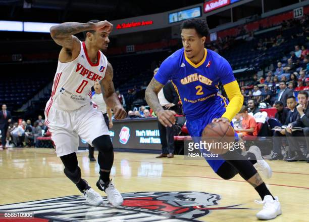 Jabari Brown of the Santa Cruz Warriors looks to get around Gary Payton II of the Rio Grande Valley Vipers at the State Farm Arena March 21 2017 in...