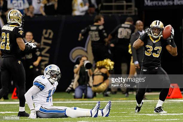 Jabari Greer of the New Orleans Saints celebrates after an interception in the fourth quarter as Titus Young of the Detroit Lions looks on during...