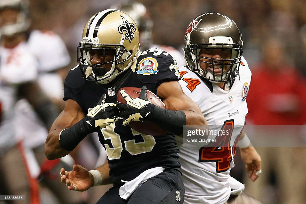 <a gi-track='captionPersonalityLinkClicked' href=/galleries/search?phrase=Jabari+Greer&family=editorial&specificpeople=2112639 ng-click='$event.stopPropagation()'>Jabari Greer</a> #33 of the New Orleans Saints intercepts a ball inteded for <a gi-track='captionPersonalityLinkClicked' href=/galleries/search?phrase=Dallas+Clark&family=editorial&specificpeople=184501 ng-click='$event.stopPropagation()'>Dallas Clark</a> #44 of the Tampa Bay Buccaneers at the Mercedes-Benz Superdome on December 16, 2012 in New Orleans, Louisiana.