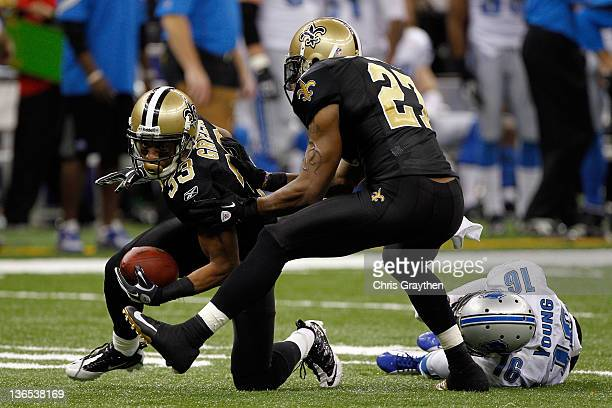 Jabari Greer of the New Orleans Saints on runs with the ball after an interception in the fourth quarter as Malcolm Jenkins looks against Titus Young...