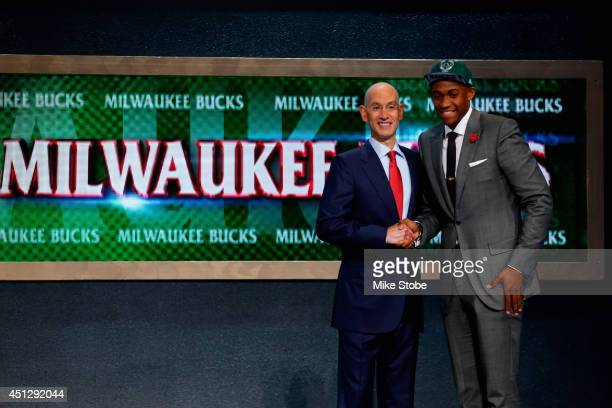 Jabari Parker of Duke poses for a photo with NBA Commissioner Adam Silver after Wiggins was drafted overall in the first round by the Milwaukee Bucks...