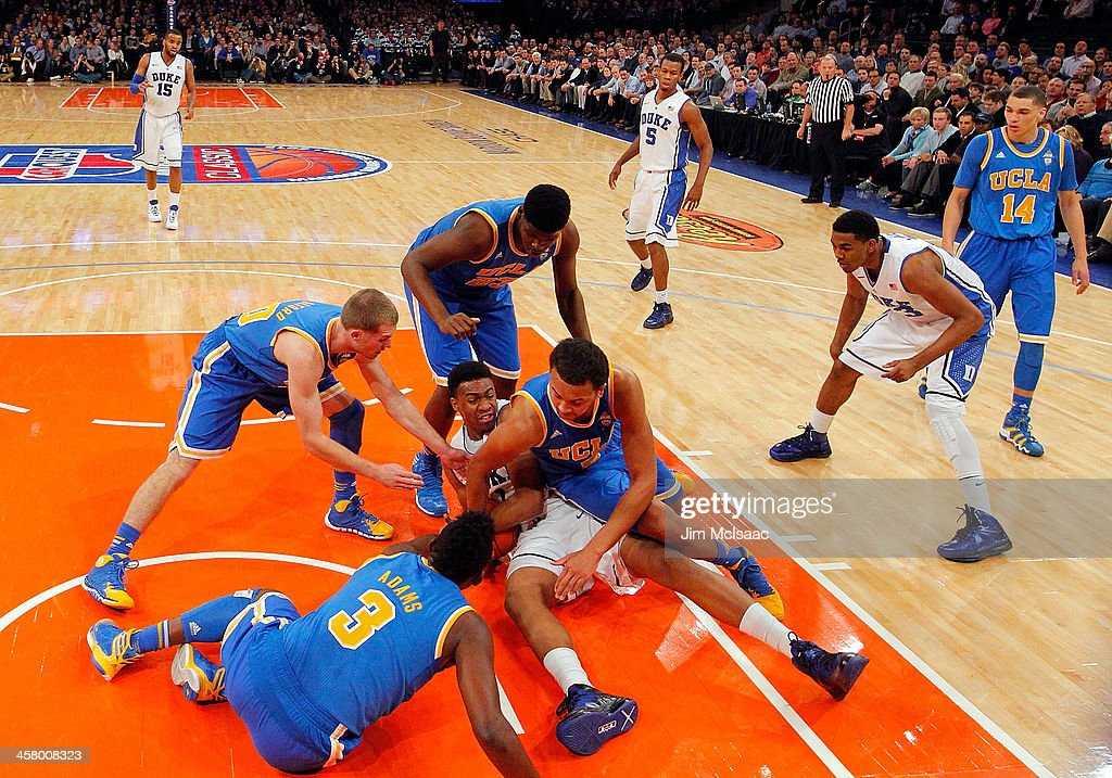 <a gi-track='captionPersonalityLinkClicked' href=/galleries/search?phrase=Jabari+Parker&family=editorial&specificpeople=9330340 ng-click='$event.stopPropagation()'>Jabari Parker</a> #1 of the Duke Blue Devils battles to keep the ball against Jordan Adams #3, Bryce Alford #20, <a gi-track='captionPersonalityLinkClicked' href=/galleries/search?phrase=Tony+Parker+-+Basketball+Player+-+Born+1993&family=editorial&specificpeople=15286432 ng-click='$event.stopPropagation()'>Tony Parker</a> #23 and Kyle Anderson #5 of the UCLA Bruins during the CARQUEST Auto Parts Classic on December 19, 2013 at Madison Square Garden in New York City.