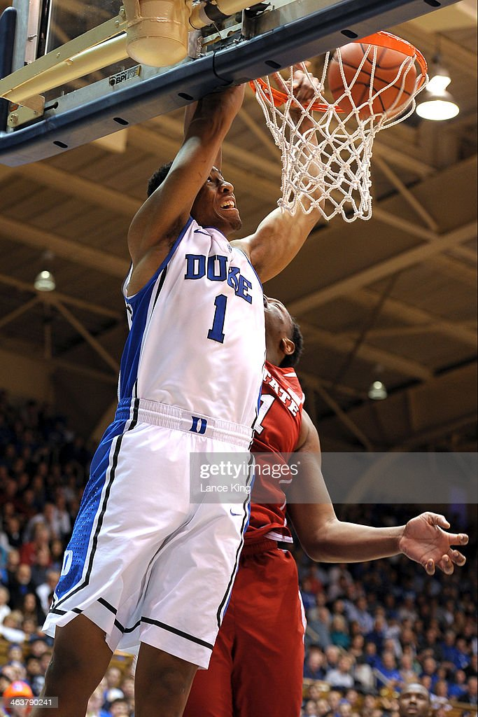 Jabari Parker #1 of the Duke Blue Devils dunks against Beejay Anya #21 of the North Carolina State Wolfpack at Cameron Indoor Stadium on January 18, 2014 in Durham, North Carolina. Duke defeated NC State 95-60.
