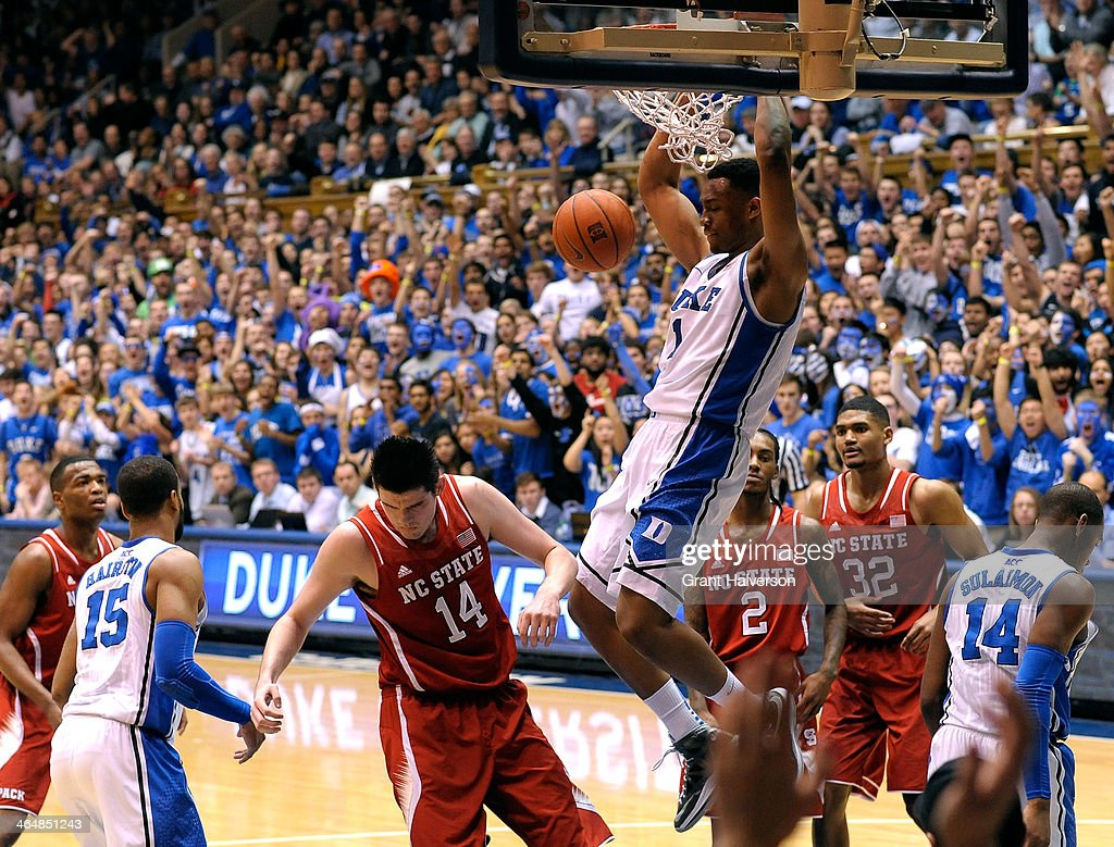 <a gi-track='captionPersonalityLinkClicked' href=/galleries/search?phrase=Jabari+Parker&family=editorial&specificpeople=9330340 ng-click='$event.stopPropagation()'>Jabari Parker</a> #1 of the Duke Blue Devils dunks over Jordan Vandenberg #14 of the North Carolina State Wolfpack during their game at Cameron Indoor Stadium on January 18, 2014 in Durham, North Carolina. Duke won 95-60.