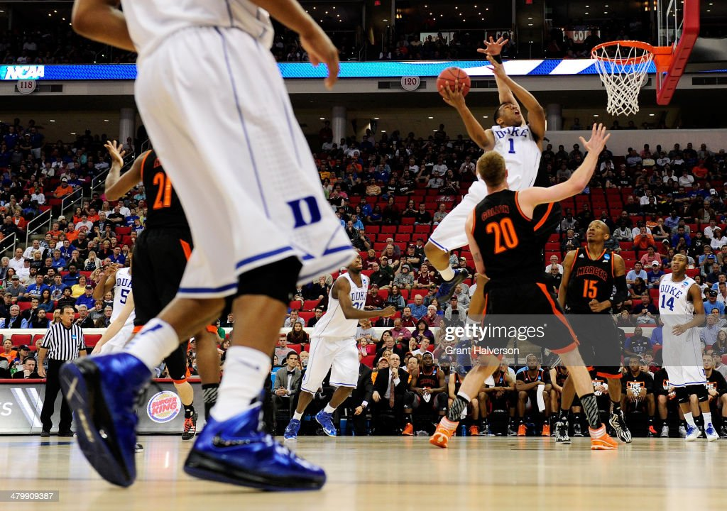 <a gi-track='captionPersonalityLinkClicked' href=/galleries/search?phrase=Jabari+Parker&family=editorial&specificpeople=9330340 ng-click='$event.stopPropagation()'>Jabari Parker</a> #1 of the Duke Blue Devils goes up for a shot against Jakob Gollon #20 of the Mercer Bears in the first half in the second round of the 2014 NCAA Men's Basketball Tournament at PNC Arena on March 21, 2014 in Raleigh, North Carolina.