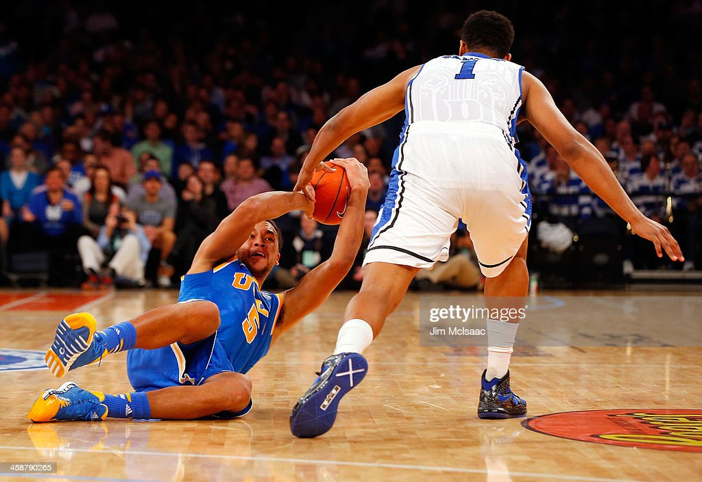 Jabari Parker #1 of the Duke Blue Devils in action against Kyle Anderson #5 of the UCLA Bruins during the CARQUEST Auto Parts Classic on December 19, 2013 at Madison Square Garden in New York City. Duke defeated UCLA