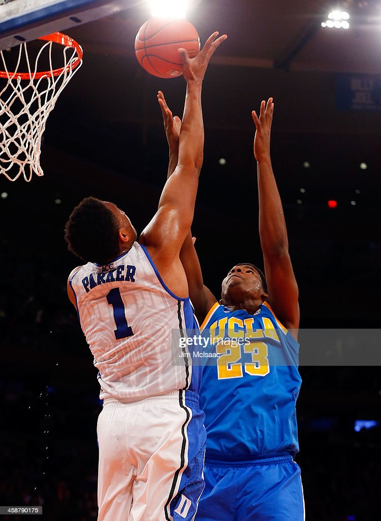Jabari Parker #1 of the Duke Blue Devils in action against Tony Parker #23 of the UCLA Bruins during the CARQUEST Auto Parts Classic on December 19, 2013 at Madison Square Garden in New York City. Duke defeated UCLA