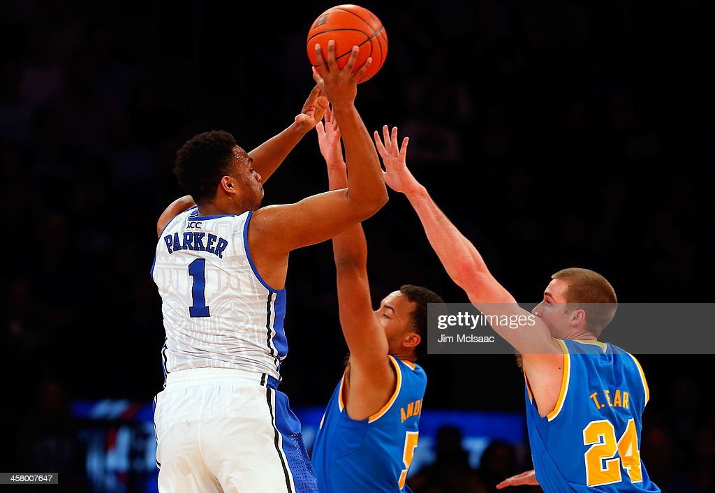 <a gi-track='captionPersonalityLinkClicked' href=/galleries/search?phrase=Jabari+Parker&family=editorial&specificpeople=9330340 ng-click='$event.stopPropagation()'>Jabari Parker</a> #1 of the Duke Blue Devils puts up a second half shot against Kyle Anderson #5 and Travis Wear #24 of the UCLA Bruins during the CARQUEST Auto Parts Classic on December 19, 2013 at Madison Square Garden in New York City.