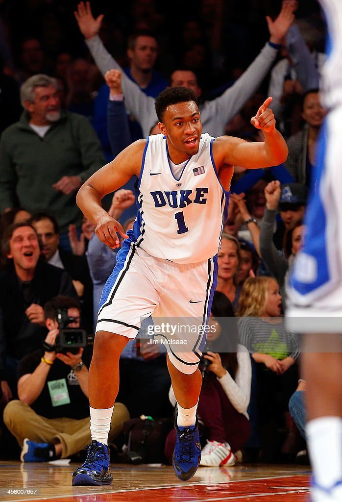 <a gi-track='captionPersonalityLinkClicked' href=/galleries/search?phrase=Jabari+Parker&family=editorial&specificpeople=9330340 ng-click='$event.stopPropagation()'>Jabari Parker</a> #1 of the Duke Blue Devils reacts after dunking the ball in the second half against the UCLA Bruins during the CARQUEST Auto Parts Classic on December 19, 2013 at Madison Square Garden in New York City.