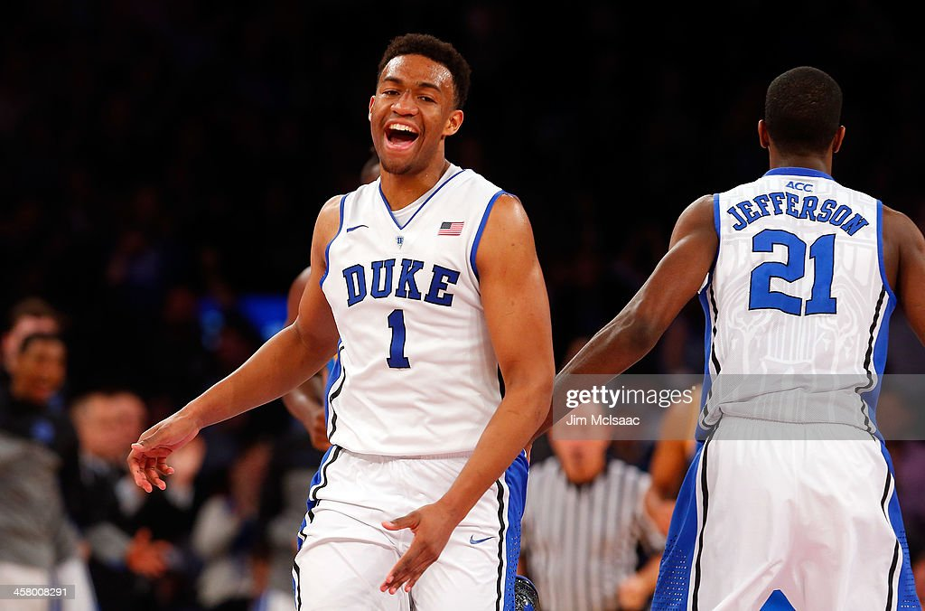 <a gi-track='captionPersonalityLinkClicked' href=/galleries/search?phrase=Jabari+Parker&family=editorial&specificpeople=9330340 ng-click='$event.stopPropagation()'>Jabari Parker</a> #1 of the Duke Blue Devils reacts after scoring a basket in the second half against the UCLA Bruins during the CARQUEST Auto Parts Classic on December 19, 2013 at Madison Square Garden in New York City.
