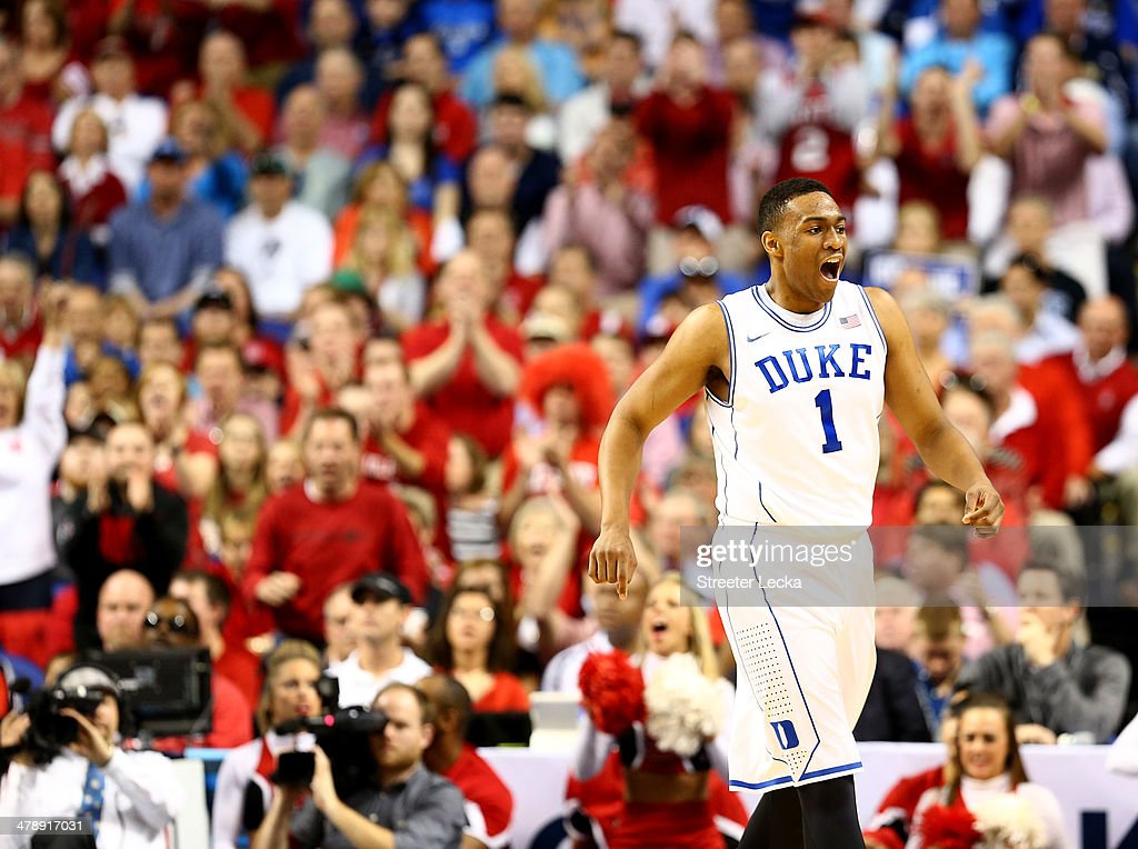 <a gi-track='captionPersonalityLinkClicked' href=/galleries/search?phrase=Jabari+Parker&family=editorial&specificpeople=9330340 ng-click='$event.stopPropagation()'>Jabari Parker</a> #1 of the Duke Blue Devils reacts against the North Carolina State Wolfpack during the semifinals of the 2014 Men's ACC Basketball Tournament at Greensboro Coliseum on March 15, 2014 in Greensboro, North Carolina.