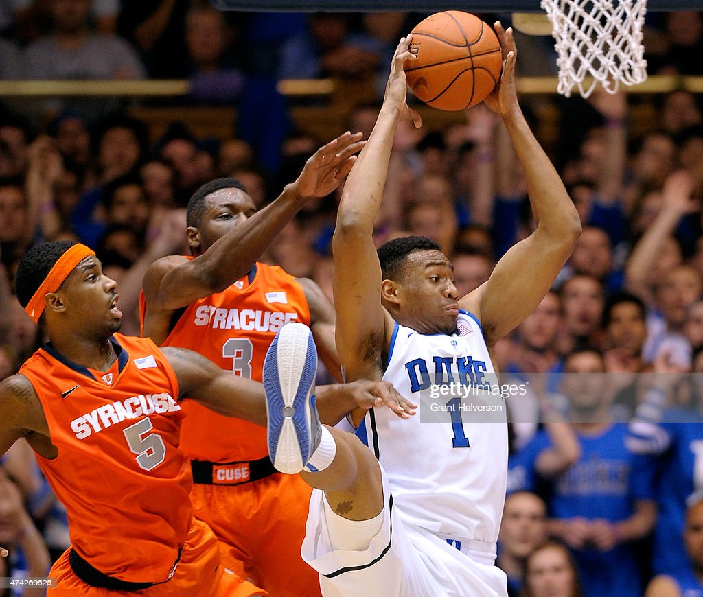 Jabari Parker #1 of the Duke Blue Devils takes a rebound away from C.J. Fair #5 and Jerami Grant #3 of the Syracuse Orange during their game at Cameron Indoor Stadium on February 22, 2014 in Durham, North Carolina. Duke won 66-60.