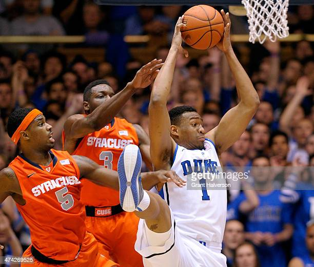 Jabari Parker of the Duke Blue Devils takes a rebound away from CJ Fair and Jerami Grant of the Syracuse Orange during their game at Cameron Indoor...