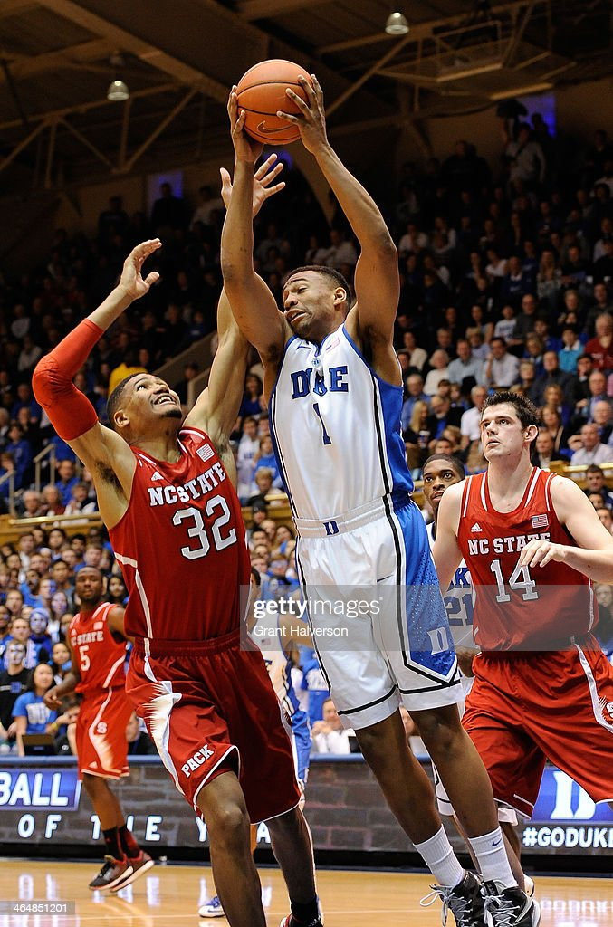 <a gi-track='captionPersonalityLinkClicked' href=/galleries/search?phrase=Jabari+Parker&family=editorial&specificpeople=9330340 ng-click='$event.stopPropagation()'>Jabari Parker</a> #1 of the Duke Blue Devils takes a rebound away from Kyle Washington #32 of the North Carolina State Wolfpack during their game at Cameron Indoor Stadium on January 18, 2014 in Durham, North Carolina. Duke won 95-60.