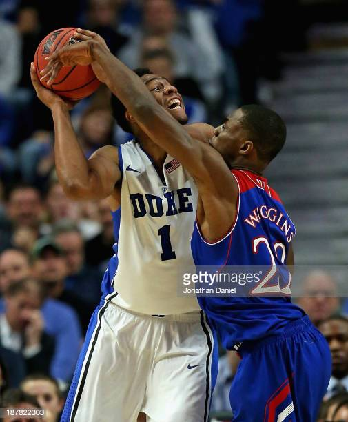 Jabari Parker of the Duke Blue Devils tries to shoot against Andrew Wiggins of the Kansas Jayhawks during the State Farm Champions Classic at the...