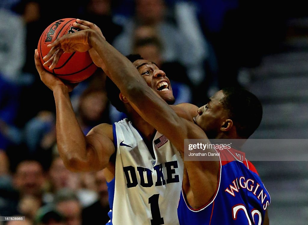 <a gi-track='captionPersonalityLinkClicked' href=/galleries/search?phrase=Jabari+Parker&family=editorial&specificpeople=9330340 ng-click='$event.stopPropagation()'>Jabari Parker</a> #1 of the Duke Blue Devils tries to shoot against <a gi-track='captionPersonalityLinkClicked' href=/galleries/search?phrase=Andrew+Wiggins&family=editorial&specificpeople=7720937 ng-click='$event.stopPropagation()'>Andrew Wiggins</a> #22 of the Kansas Jayhawks during the State Farm Champions Classic at the United Center on November 12, 2013 in Chicago, Illinois. Kansas defeated Duke 94-83.