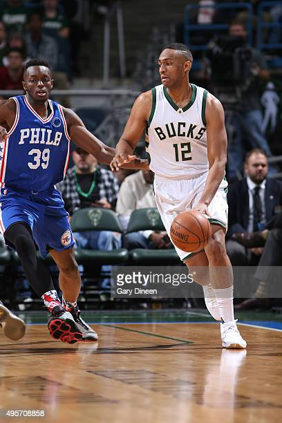 Jabari Parker of the Milwaukee Bucks brings the ball up court against Jerami Grant of the Philadelphia 76ers on November 4 2015 at the BMO Harris...
