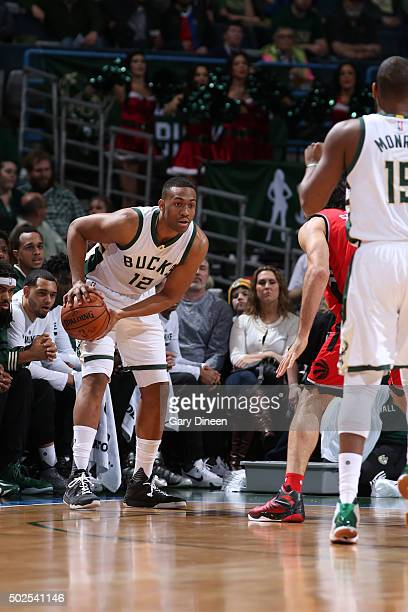 Jabari Parker of the Milwaukee Bucks defends the ball against the Toronto Raptors during the game on December 26 2015 at BMO Harris Bradley Center in...