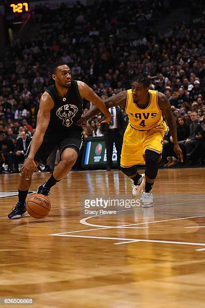 Jabari Parker of the Milwaukee Bucks drives to the basket against Iman Shumpert of the Cleveland Cavaliers during a game at BMO Harris Bradley Center...