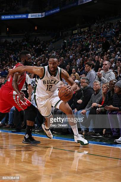 Jabari Parker of the Milwaukee Bucks drives to the basket against the Houston Rockets on January 23 2017 at the BMO Harris Bradley Center in...