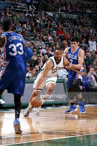 Jabari Parker of the Milwaukee Bucks drives to the basket against the Philadelphia 76ers on January 25 2017 at the BMO Harris Bradley Center in...