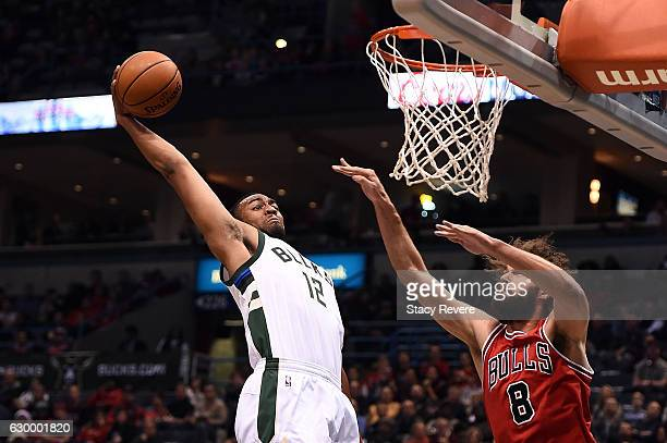 Jabari Parker of the Milwaukee Bucks dunks against Robin Lopez of the Chicago Bulls during the first half of a game at the BMO Harris Bradley Center...