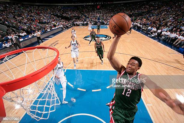 Jabari Parker of the Milwaukee Bucks dunks against the Dallas Mavericks on December 7 2014 at the American Airlines Center in Dallas Texas NOTE TO...
