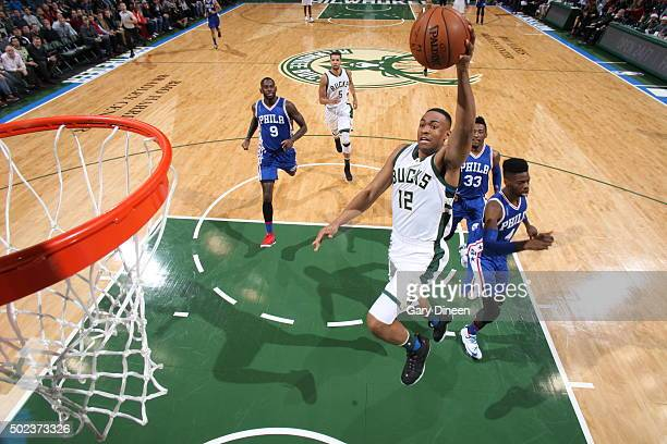 Jabari Parker of the Milwaukee Bucks goes to the basket against the Philadelphia 76ers on December 23 2015 at the BMO Harris Bradley Center in...