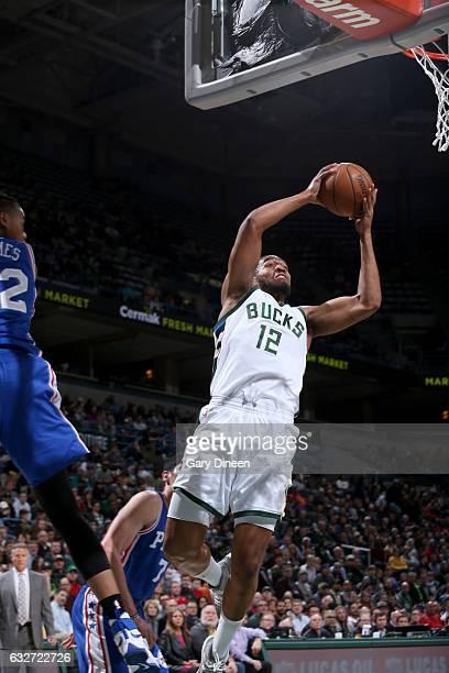 Jabari Parker of the Milwaukee Bucks goes to the basket against the Philadelphia 76ers on January 25 2017 at the BMO Harris Bradley Center in...