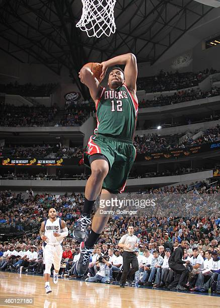 Jabari Parker of the Milwaukee Bucks goes up for a dunk against the Dallas Mavericks on December 7 2014 at the American Airlines Center in Dallas...