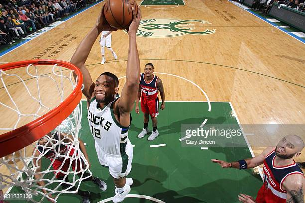 Jabari Parker of the Milwaukee Bucks goes up for a dunk during a game against the Washington Wizards on January 8 2017 at the BMO Harris Bradley...