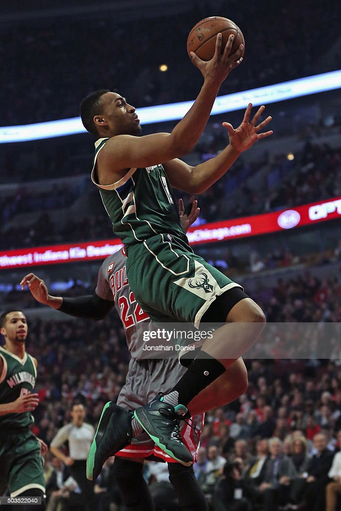 <a gi-track='captionPersonalityLinkClicked' href=/galleries/search?phrase=Jabari+Parker&family=editorial&specificpeople=9330340 ng-click='$event.stopPropagation()'>Jabari Parker</a> #12 of the Milwaukee Bucks goes up for a shot past <a gi-track='captionPersonalityLinkClicked' href=/galleries/search?phrase=Taj+Gibson&family=editorial&specificpeople=4029461 ng-click='$event.stopPropagation()'>Taj Gibson</a> #22 of the Chicago Bulls at the United Center on January 5, 2016 in Chicago, Illinois.